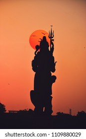 This is a silhouette shot lord shiva statue, which is situated in Baroda, Gujarat