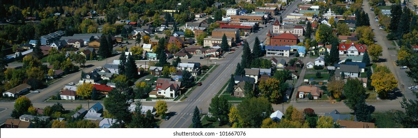 This is a small town in the western part of the United States. It is autumn and shows small town America with houses lined up on tree lined suburban streets.