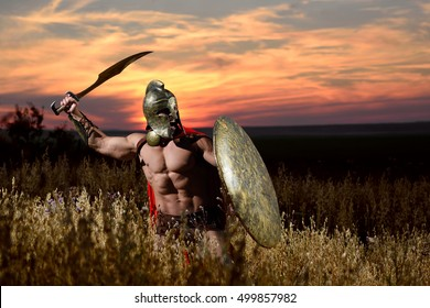 This is Sparta! Brutal aggressive screaming Spartan warrior ready to attack his enemy during a battle
