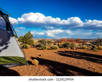 This is a spectacular tent view overlooking the Maze Overlook in the Canyonlands National Park in Utah. The chocolate drops formation is seen in the background.