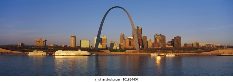 This is the St. Louis skyline at sunrise. It is situated along the Mississippi River.