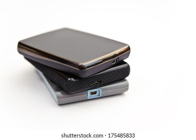 This stack of portable hard drives isolated on white.