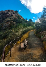 This is the steep Thumb Butte Trail in Prescott National Forest, Prescott, AZ. The railings are for protection: the bench is for  temporary rest while ascending. Thumb Butte is above to the left.