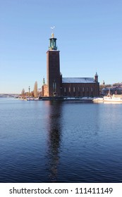 This is the stockholms stadshus in winter with a reflection.