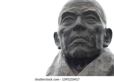"""This is a stone statue of """"Taira no Kiyomori"""", a warlord of the past in Japan.This is located in Miyajima island,Hiroshima."""