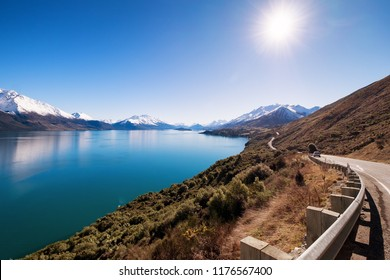 This stretch of road is very famous in New Zealand. It links Queenstown to Glenorchy. Along this road, one can enjoy beautiful scenery like river, mountain, and spectacular views.
