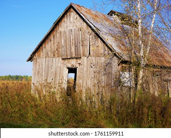 This structure still holds despite the seasons and the past. It is still used to shelter hay. She finds herself near the fields and near the road. Acton Vale, Quebec, Canada; October 19, 2018.