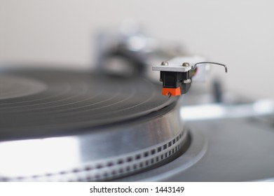 This stylish 20-years old turntable is ready to play disk. The tone-arm cartridge is in focus. You can put your logo and text on it. Very shallow DoF with focus on tip of red.