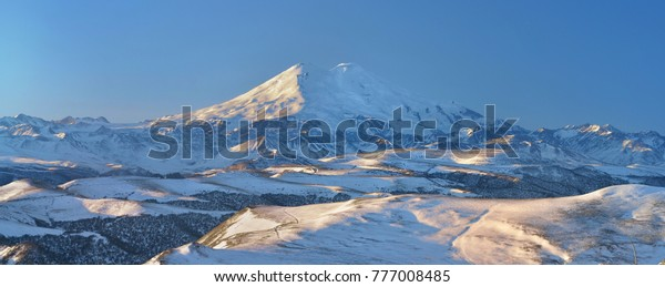 This is sunny morning in Caucasus mountains in winter