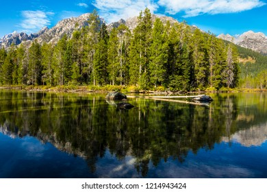 This is a symmetrical mirror image of the Teton peaks and forests upon Leigh Lake in the Grand Teton National Park in Wyoming.