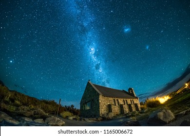 This was taken in Lake Tekapo, New Zealand. One can see milky way, galaxies, and stars in the night sky. The place is famous and popular among tourist, travelers and holiday makers.