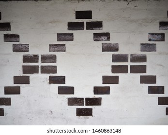 This is taken at a trainstation in Denmark where the wall has a special pattern made in brick stones.