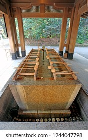 This is a chōzuya or temizuya which is a Shinto water ablution pavilion used for a ceremonial purification rite known as temizu. These ones are at the Meiji Shrine in the Shibuya area of Tokyo.