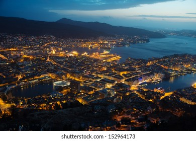 This is a top view of Bergen (the west coast of Norway) in night. The town is illuminated.