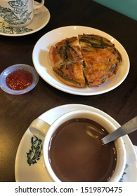 This is a traditional baba nyonya snack which is known as the 'cucur udang', paired with a cup of coffee