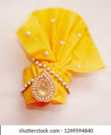 This is a traditional wear called as Turban also known as Pagadi or petha which is used to wear in every Hindu Festival celebrated in and around India.