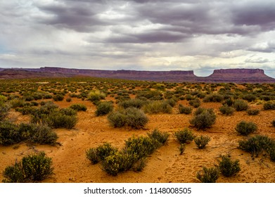 This U shaped distant land formation, creates interest in this image. The panoramic desert view along the remote road to Millard Canyon in the Maze of Canyonlands NP , completes the   composition.