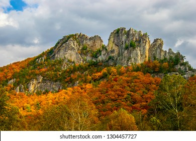This is the upper area of Seneca Rocks National Recreational Area in the Monongahela National Forest in West Virginia. Beautiful orange Autumn colors surround the rocks of this famous climbing area.