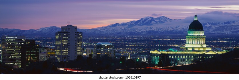 This is Utah's State Capitol, Great Salt Lake and Snow Capped Wasatch Mountains at sunset.