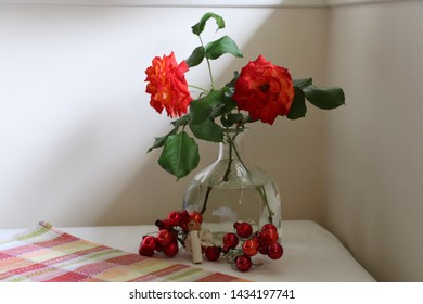 This is a vase and two roses someone who rented me a room put on my table