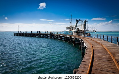 This is Venus Bay on the Eyre Peninsula, in South Australia. It is a small pretty seaside holiday town with an impressive curved jetty which was popular with fishing.