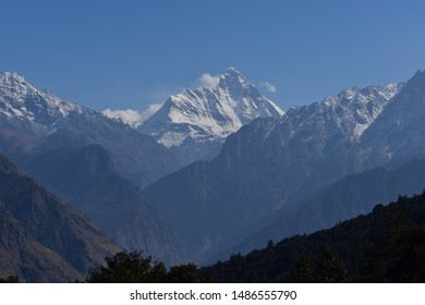 This is a very beautiful picture of nature. This picture view of contains Mountains,blue sky,clouds,valley and snow. This picture was clicked near badrinath India.