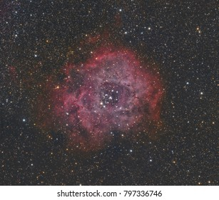 This is a very large circular emission nebula called The Rosette (for obvious reasons) in the constellation Monoceros. It is a huge cloud of dust and gas and covers an area about 5 times the size of a