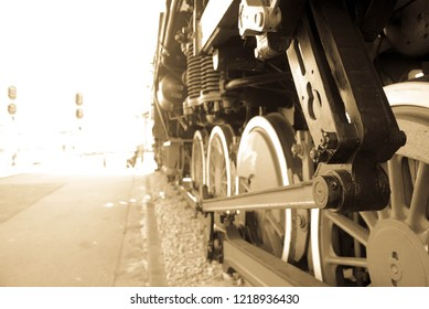 this is a very old train which was restored. the photograpy represents train wheels of the industrial era