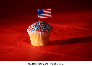 This is a very patriotic cupcake.  Vanilla bean with buttercream icing adorned with red, white, and blue sprinkles,  and proudly finished with The Stars and Stripes.