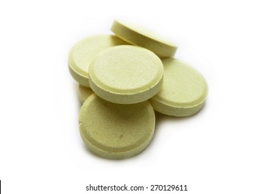 This is a view of calcium tablets on white background.