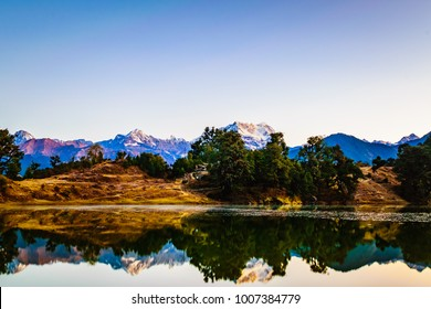 This is the view of Chaukambha mountains from Deoria Tal nestled in Garhwal Himalayas at Chopta, Uttarakhand, India. This lake at an altitude 2438m is a camping site for Tungnath Chandrashila trek.