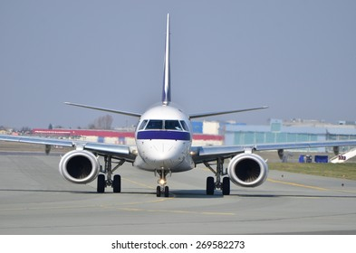 This is a view of Embraer ERJ 170 PLL LOT registered as SP-LNA on the Warsaw Chopin Airport. April 11, 2015. Warsaw, Poland.