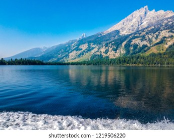 This is a view of Jenny Lake with the Teton mountains in the background.  Mountain reflections are seen on the lake.This area is located in the Grand Teton National Park in Wyoming.