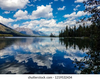 This view of Leigh Lake shows the spectacular reflections of the clouds, sky, water, and mountains, upon Leigh Lake, in the Grand Teton National Park in Wyoming.