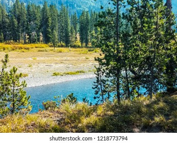 This is a view of the Lewis River in Yellowstone National Park in Wyoming. The azure sky reflects its beautiful color upon the waters.