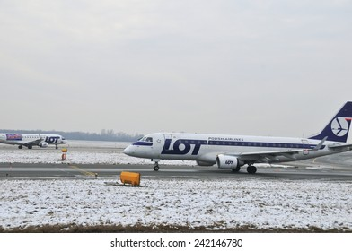 This is a view of LOT-Polish Airlines plane Embraer ERJ170 registered as SP-LIC on the Warsaw Chopin Airport. December 31, 2014. Warsaw, Poland.