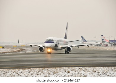This is a view of LOT-Polish Airlines plane Embraer ERJ 170 registered as SP-LII on the Warsaw Chopin Airport. December 31, 2014. Warsaw, Poland