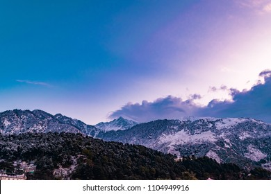 This is the view from Mcleodganj with snowcladded himalyan peaks of Dhauladhar range after fresh snowfall during sunrise on a winter morning at Dharamsala, India.