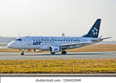 This is a view of LOT plane Embraer ERJ 170 painted as Star Alliance Group on the Warsaw Chopin Airport. February 28, 2019. Warsaw, Poland.