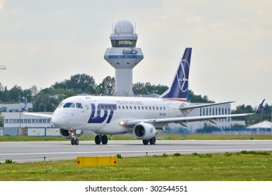 This is a view of LOT - Polish Airlines plane Embraer ERJ 170 STD registered as SP-LDF on the Warsaw Chopin Airport. July 30, 2015. Warsaw, Poland.