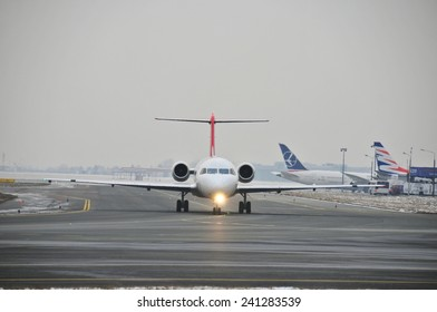 This is a view of Swiss Helvetic plane Fokker F100 registered as HB-JVE on the Warsaw Chopin Airport. December 31, 2014. Warsaw, Poland