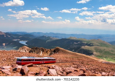 This is a view from the top of the  Pikes Peak Highway in Colorado Springs, Colorado.. The Pikes Peak Cog Railway is about to depart for the bottom of the mountain.