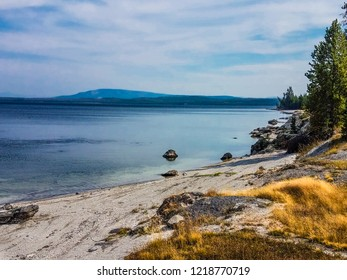 This is a view of Yellowstone Lake taken in the West Thumb Geyser Basin area in Yellowstone National Park in Wyoming. Distant peaks are seen across this very large lake.