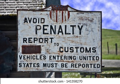This is a vintage, turn of the century sign of the United States custom, border crossing.  Background is a vintage building and tools.