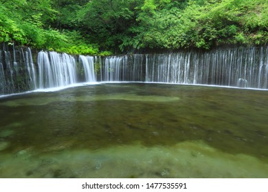 This waterfall called Shiraitonotaki is in Karuizawa Town, Nagano Prefecture, Japan. Water of that is spring water, so very clear and beautiful.
