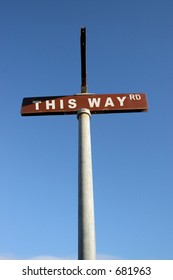 THIS WAY street sign