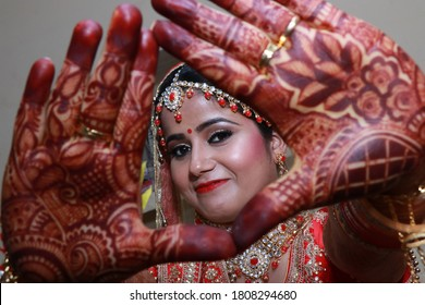 This is a wedding photo. Indian bride is flaunting her bridal mehendi. It is a tradition in our country India to put henna in hands for shagun means good luck.