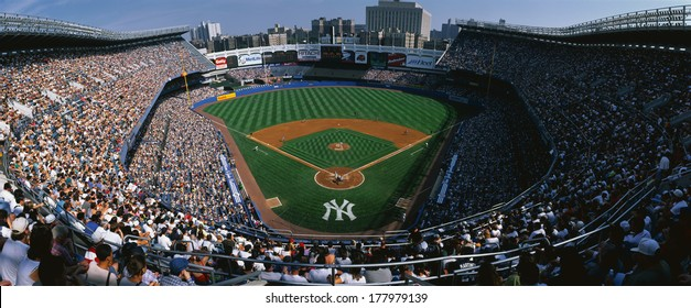This is Yankee Stadium. This was the Yankees' 114th victory. The score was 8 to 3 over the Tampa Bay Daredevils. The Yankees were the 1998 World Champions. The attendance at this game was 49,680.