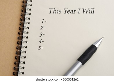 """""""This Year I Will"""" written on book with blank listing, planning conceptual"""