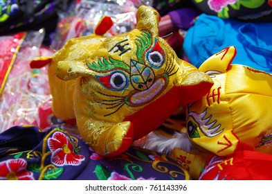 This is the yongxing xian fang snack street selling tiger shoes. The tiger shoes is a kind of traditional culture of China.